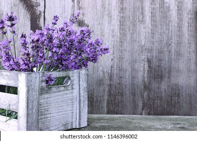 Lavender flowers  in wooden box on wooden background