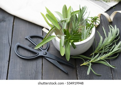 lavender, hyssop, clary and savory leaves bunch making on black wood table