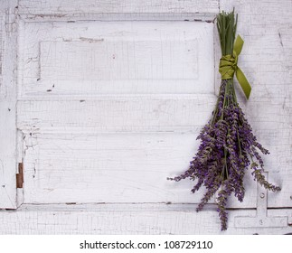 lavender laying on an old door panel, room for copy space