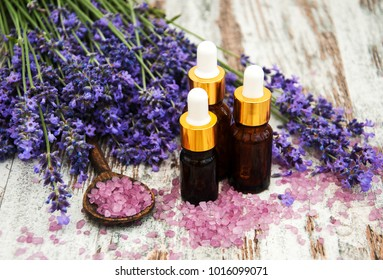Lavender and massage oil on a old wooden background