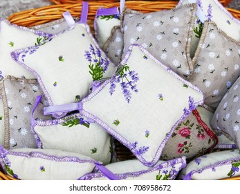 Lavender mini pillows with hanging filled with dry lavender flowers. Handcrafted lavender cotton sachets with crocheted margins.