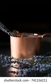 Lavender mint moscow mule cocktail on dark background