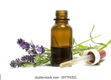 lavender oil, flowering branches and a bottle with dropper isolated on a white background