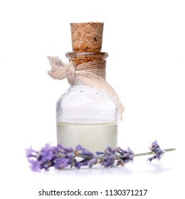 Lavender oil in glass bottle isolated on white background