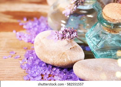 lavender oil in a glass bottle on a background of fresh flowers. Aromatherapy.