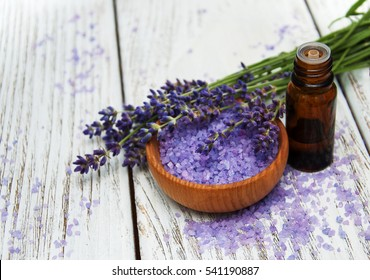Lavender with oil on a wooden background