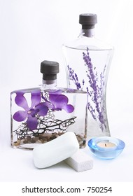 lavender oil, soap, candle on white background