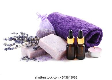 Lavender oil with soap and flowers isolated on white