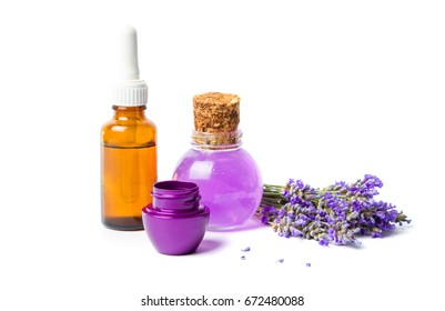 Lavender oils and flowers bouquet isolated on white