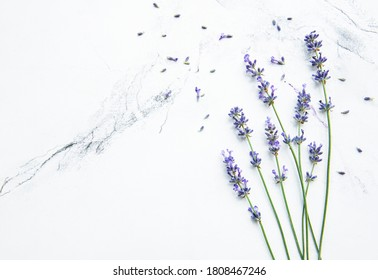 Lavender  on a white marble  background with space for text, top view