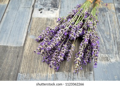 Lavender on a wooden background stock images. Bunch of french lavender. Relaxing scented lavender flowers on empty wooden background