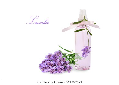 Lavender product in spray bottle and flowers isolated on white background.
