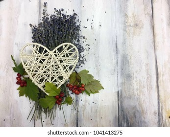 lavender and rowan berries on a wooden background