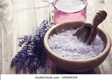 Lavender salt in a bowl on wooden background