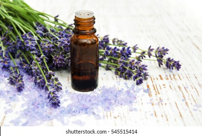 Lavender, sea salt and oil on a wooden background