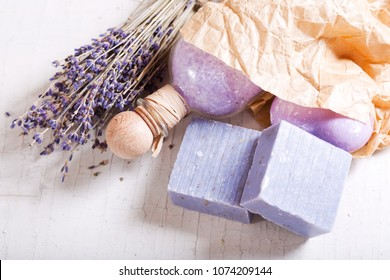 lavender spa products on a wooden table, top view