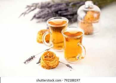 Lavender tea and Kadaif on a light background. Selective focus