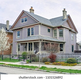 Lavender Victorian House with Spring Plants
