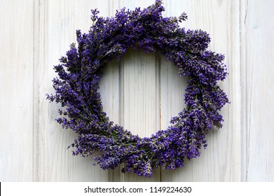 Lavender wreath on an old white wooden door.