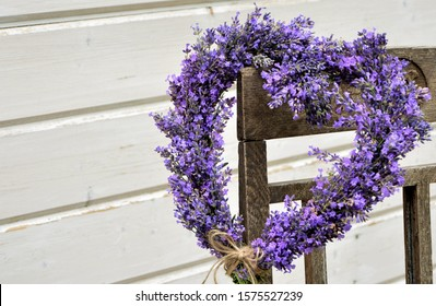 Lavender wreath in the shape of a heart on a chair close-up