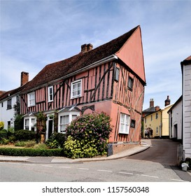 LAVENHAM, SUFFOLK, UK - AUGUST 4, 2018. An ancient distorted, leaning timber framed cottage, alleged to be the origin of The Crooked Man nursery rhyme, located at Lavenham, Suffolk, England, UK.