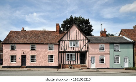LAVENHAM, SUFFOLK, UK - AUGUST 4, 2018. A row of ancient cottages, located at Lavenham, an English village in the county of Suffolk, UK.