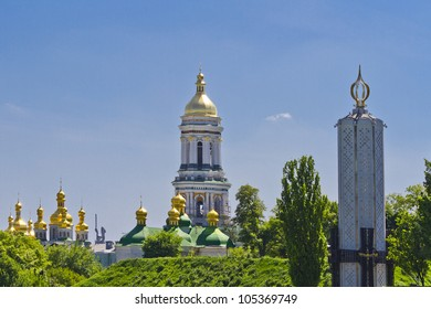 Lavra Bell tower and Holodomor Memorial to Famine in USSR. Holodomor is specifically applies to the Famine that took place in territories population by ethnic Ukrainians. Kiev, Ukraine, Europa.