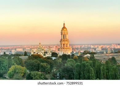 Lavra bell tower and Lavra  orthodox church and monastery (UNESCO World Heritage 527)  on golden sunset against left bank of Kyiv city, 2005 October 06, Kyiv (Kiev), Ukraine