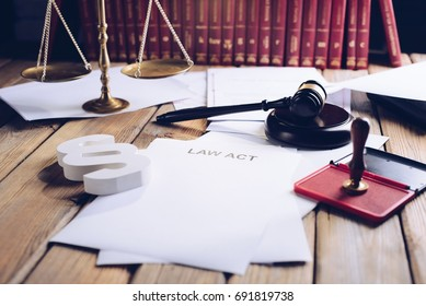 Law act on old wooden desk in library, law office