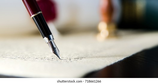Law background theme. Fountain pen and handmade paper. law lawyer pen will notary paper legacy background concept