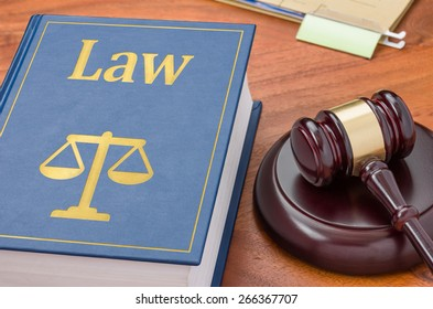 A law book with a gavel - Law