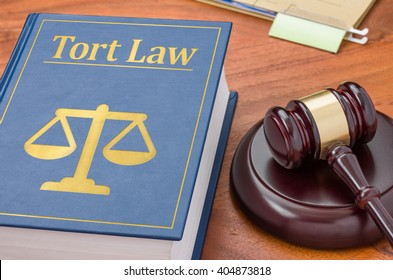A law book with a gavel - Tort law