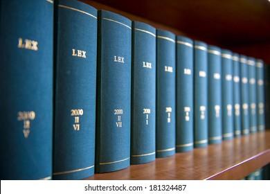 Law books in al law office's bookshelf.