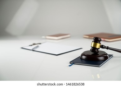 Law business.Lawyers office. Gavel on white table. Bokeh background.