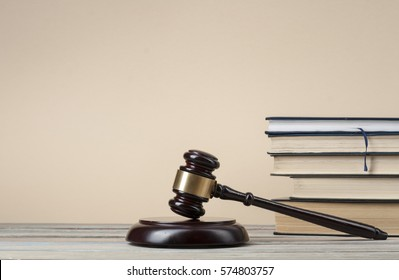 Law concept - Books with wooden judges gavel on table in a courtroom or  enforcement office.Copy space for text.