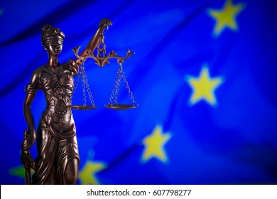 Law concept Gavel and Lady of Justice on wooden table, EU flag