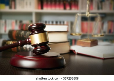 Law concept with gavel and scale in background. Composition in court library