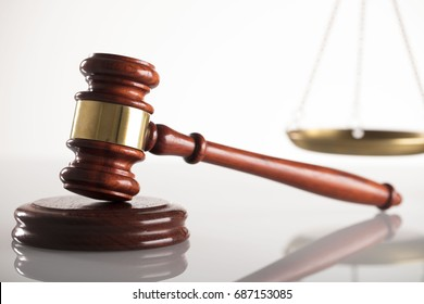 Law concept. Gavel, Scales. White background.