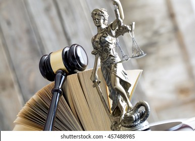 Law concept. Gavel, statue and book