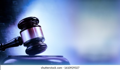 Law concept image, gavel set against bright computer monitor screen background