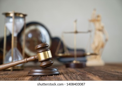 Law concept. Judge gavel, statue of the justice. Wooden table.