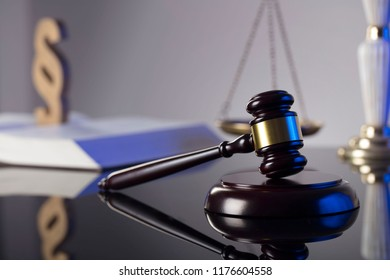 Law concept. Judge's gavel, statue of justice, scales, books, clock. Place for typography.