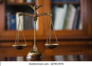 Law concept. Judges mallet with justice scales and books on wooden rustic table, place for typography