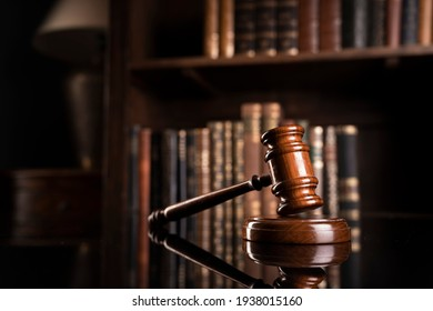 Law concept. Justice symbol on book background.