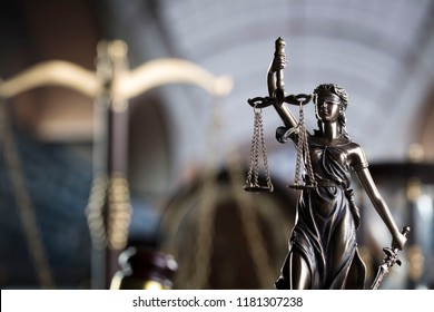 Law concept. Old library, scales, statue of justice, clock, hourglass. Bokeh background. Place for typography.