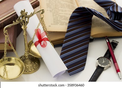 Law concept, scale, books, degree and tie