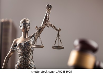Law concept, Scales sculpture and wooden gavel