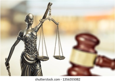 Law concept, sculpture and gavel            - Image