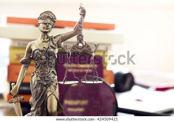 Law concept, statue, magnifying glass, passport and book