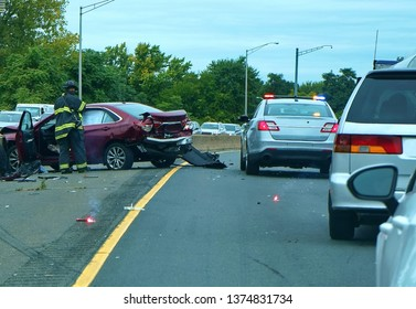 Law enforcement and emergency services quickly respond to a freeway multiple car collision.